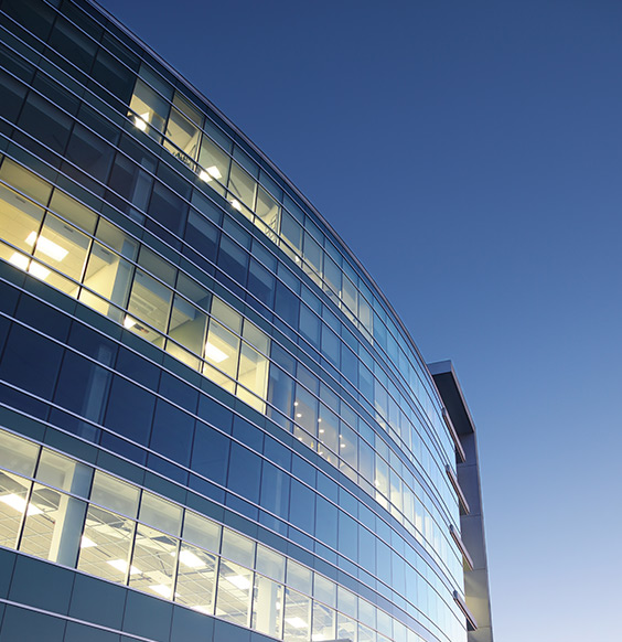 Glass office at dusk